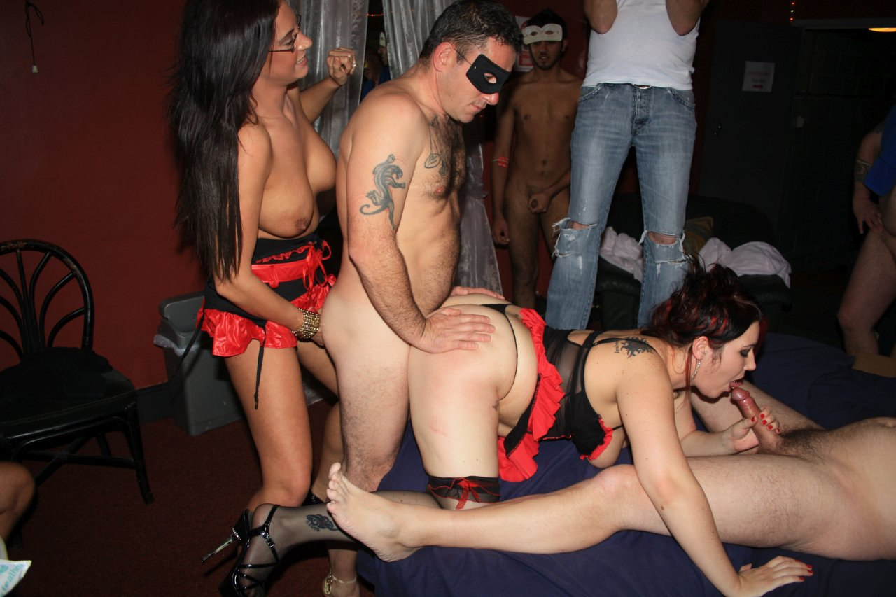 Group sex orgy in a club