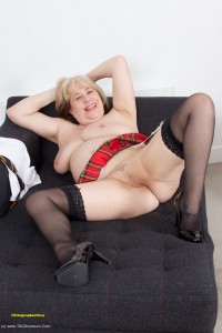 Mature slut in tartan skirt plays with herself
